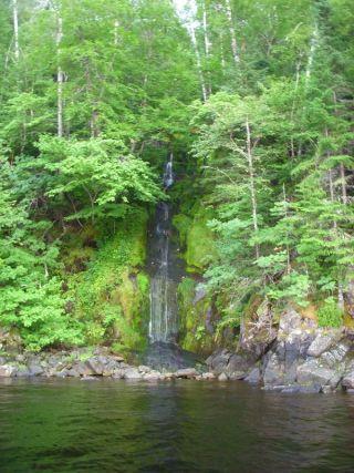 Small waterfall along shore