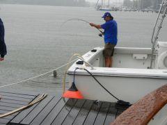 "Boat neighbor Frank lands catfish during ""Hurricane"" Irene"